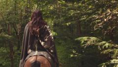 Fantasy / Medieval Girl riding Horse Stock Footage