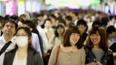 Slow Motion - Passengers hurry at Ikebukuro station in Tokyo, Japan. - stock footage