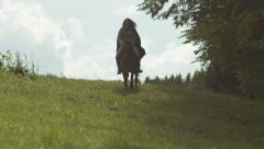 Fantasy / Medieval Girl riding Horse Slow Motion Stock Footage