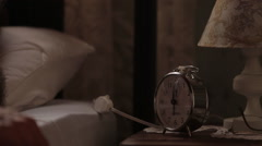 Male hand lighting lamp and alarm clock turning off the headboard, close up Stock Footage