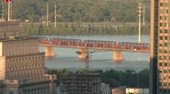 4K UHD Cityscape - Bridge with cars and train over water on sunny day Stock Footage