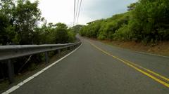 Car travels along virgin island roads Stock Footage