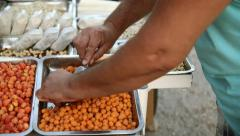 Traditional street cart vendor in Greece selling nuts dry seed snacks Stock Footage