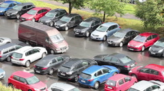 Camera review harking zone with lot of cars near business center in downtown Stock Footage