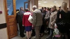 Crowd of parents in hall and stairs coming out of school. September, 1 in Russia Stock Footage