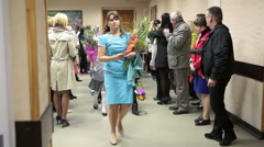 Teacher with first graders passing the school hall through the parents Stock Footage
