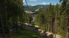 The chair lift in the mountains summer Bukovel Stock Footage
