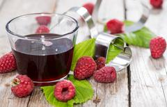 raspberry sirup in a glass - stock photo