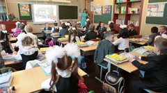 Teacher entering class and starting first lesson in initial school - stock footage