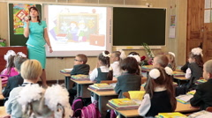 Teacher explains the lesson for pupils in school. September, 1 in Russia Stock Footage