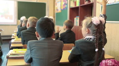 Girl raises a hand for answer teacher at the school lesson. September, 1 - stock footage