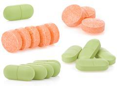 Pills on white Stock Photos