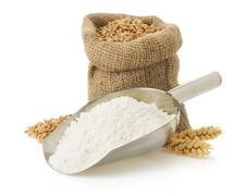 wheat flour and bread on white - stock photo