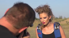 Young sexy girl model posing with a parachute fo man photographer photo shoot - stock footage