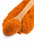 Paprika powder and spoon Stock Photos