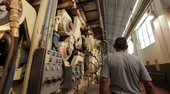 Employee operating large machine Stock Footage