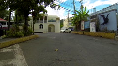 Jeep drives through the city in the Virgin Islands Stock Footage