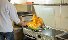 Fire in a frying pan Stock Photos