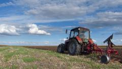 Farmer cultivates land - stock footage