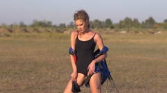 Young sexy girl model posing with a parachute for photo shoot - stock footage