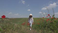 Happy Little Girl Walking, Countrywoman Child in Poppy Flower Field, Children Stock Footage