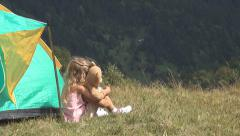 Little Girl Playing with Grass by Tent in Mountains, Child in Trip in Camping - stock footage