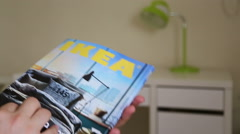 Editorial holding IKEA catalogue - stock footage