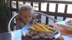 Little Girl Eating Fried Potatoes, Roast, Grill, Child Having Dinner, Lunch Stock Footage