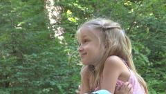 Portrait Thinking, Pensive Child, Little Girl Face Looking in Camera in Forest - stock footage