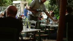 Waiter serving people at traditional cafe in Monastiraki Athens 01 - stock footage