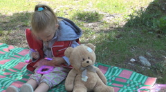 Child Relaxing, Playing on Blanket after Picnic, Little Girl Resting on Meadow Stock Footage