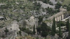 Beautiful landscape with old fortress, rocky mountains and trees. 25 fps. - stock footage