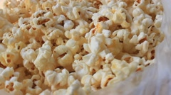 White popcorn containing in plastic bag Stock Footage