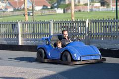 Father and child having fun on a go cart Stock Photos
