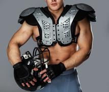 American football player with helmet and armour Stock Photos