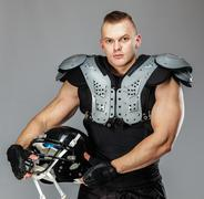 american football player with helmet and armour - stock photo