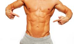 Sporty muscular man showing his abdominals Stock Photos