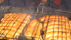 Sausages fried on a grill Stock Footage
