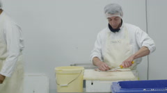 Portrait of cheerful worker in a seafood processing factory - stock footage