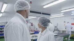 Portrait of cheerful workers in the butchery department of a food processing fac - stock footage