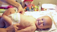 Mom wears a little baby girl - stock footage