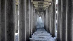 Waves under pier Stock Footage