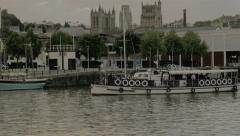 Tower Belle Ship sailing past Lloyds buiding in bristol docks Stock Footage