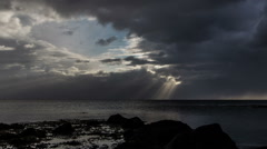 Distant sun rays over ocean during passing storm, Iceland Stock Footage