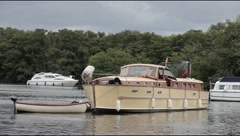 Vintage motor cruiser mooring on Salhouse Broad Stock Footage