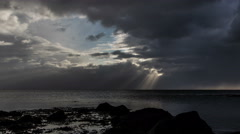 Distant sun rays over ocean during passing storm, Iceland 4k Stock Footage