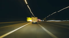 Car driving night time lapse along the M25 motorway Stock Footage