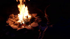 Camper Eats by Campfire Stock Footage