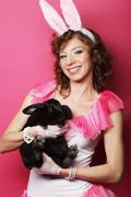 happy woman with black rabbit - stock photo