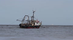 Fishing boat trawling near to shore (4/4) Stock Footage